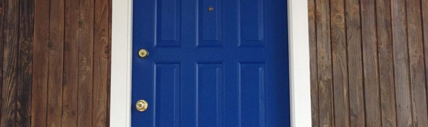 wood siding with blue door