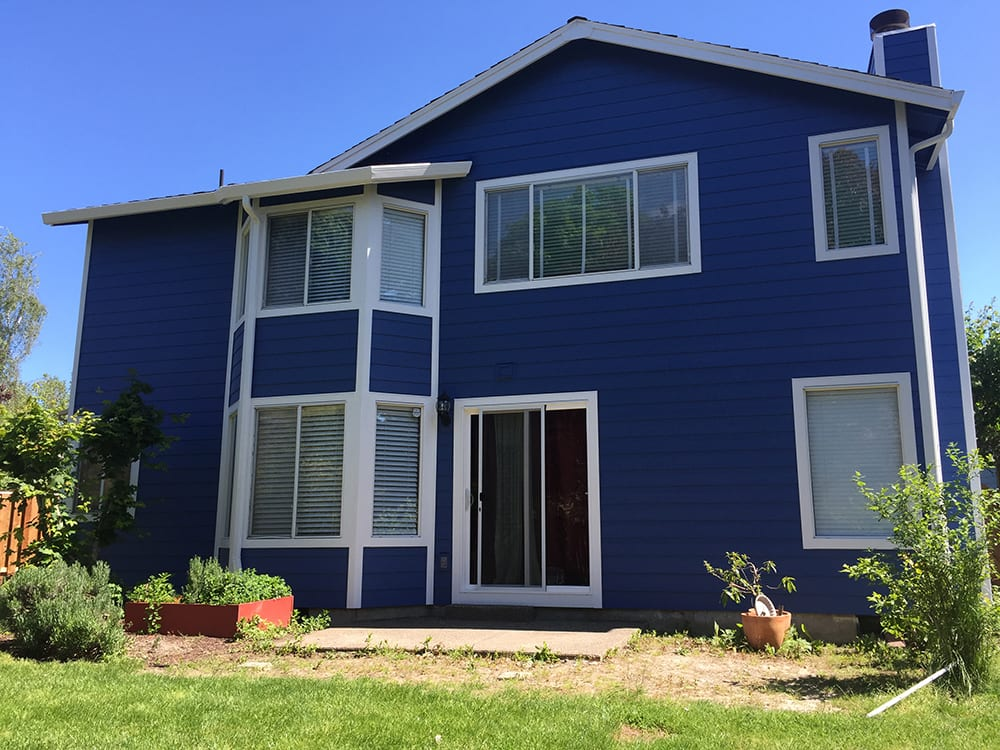 after siding blue house