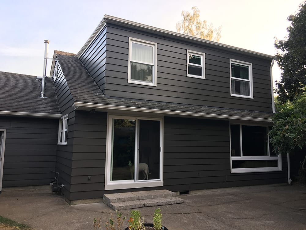 after siding dark grey house