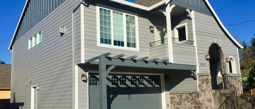 example of new paint on a grey home