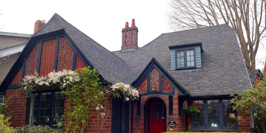 brick home with malarkey roofing example